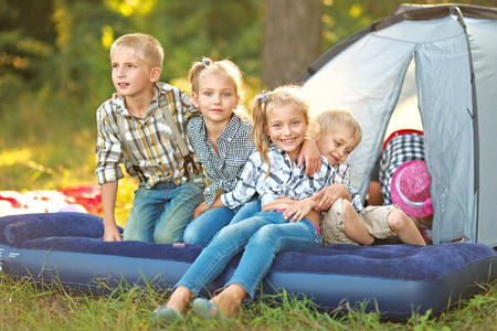 gaiety: Portrait of young children on a camping holiday