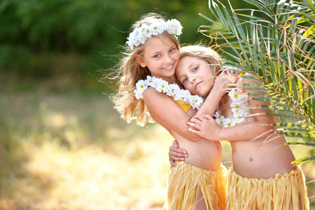 twin sister: portrait of two sisters twins in tropical style
