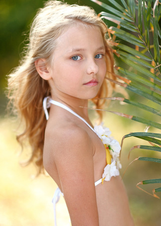 skirts: portrait of little girl in tropical style Stock Photo