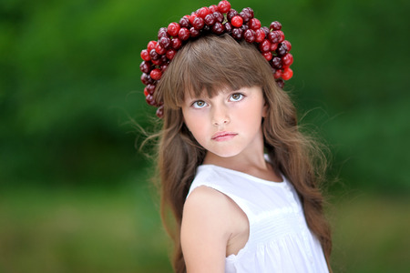 exhilaration: portrait of little girl with a wreath of cherry