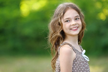 portrait of a beautiful little girl in summer Stock Photo
