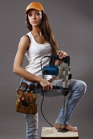 sexy young woman construction worker Stock Photo