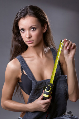 sexy construction worker: sexy young woman construction worker Stock Photo