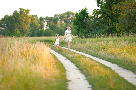 mum: portrait of mother and daughter in nature