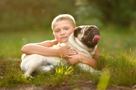 merriment: Portrait of a boy with dog pug Stock Photo