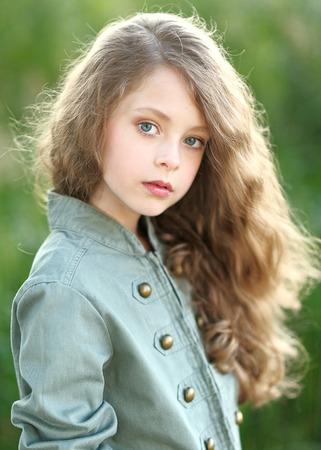little model: portrait of little girl outdoors in summer Stock Photo