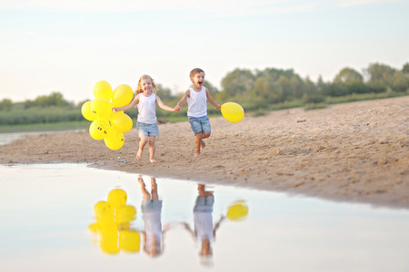 happy family: Portrait of a boy and girl on the beach in summer Stock Photo