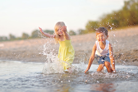 Portrait of a boy and girl on the beach in summer Archivio Fotografico