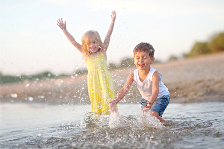 relaxing on beach: Portrait of a boy and girl on the beach in summer Stock Photo