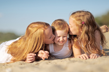 in loved: Portrait of a boy and his two sisters loved Stock Photo
