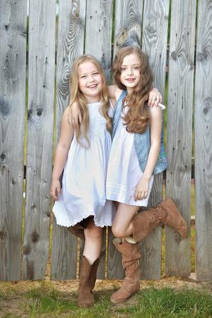 merriment: Portrait of two girls in the woods girlfriends