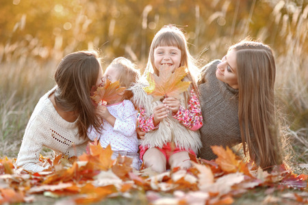 portrait of a beautiful family in autumn