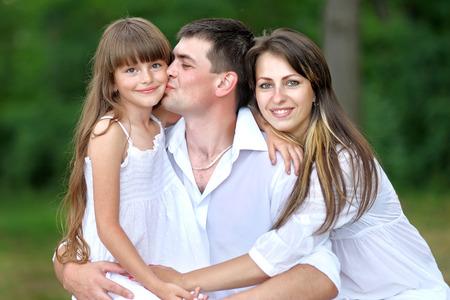 portrait of a happy family in summer nature Archivio Fotografico