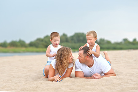 portrait of a happy family in summer nature Stock Photo