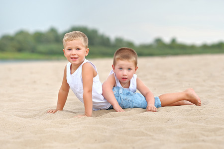 merriment: Portrait of children on the beach in summer Stock Photo