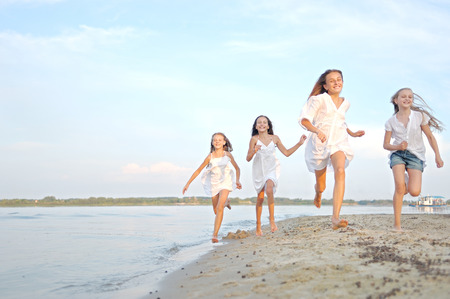 beach sun: Portrait of children on the beach in summer Stock Photo