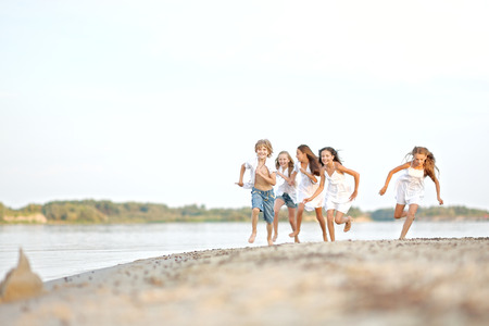 girl friends: Portrait of children on the beach in summer Stock Photo