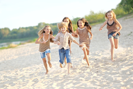 exhilaration: Portrait of children on the beach in summer Stock Photo
