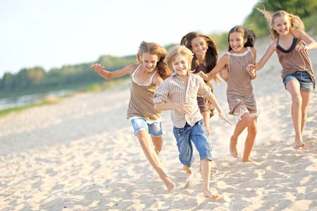 joyfulness: Portrait of children on the beach in summer Stock Photo