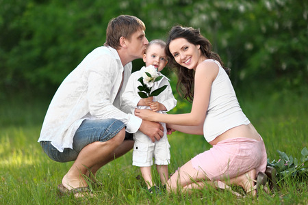 merriment: Portrait of a happy mother, dad and baby Stock Photo