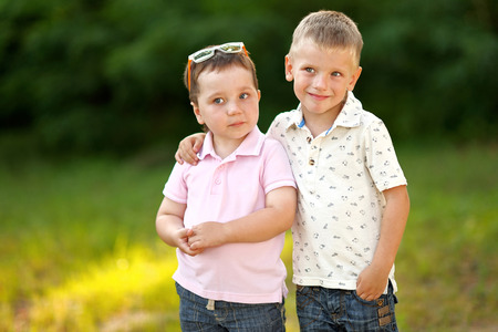 joyfulness: portrait of two little boys friends in summer