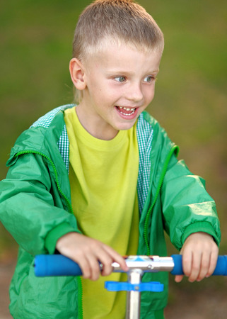merriment: Portrait of cute little boy  in summer