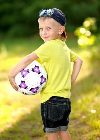 exhilaration: Portrait of cute little boy  in summer