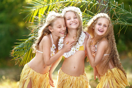 portrait of three girls in a tropical style Stock Photo