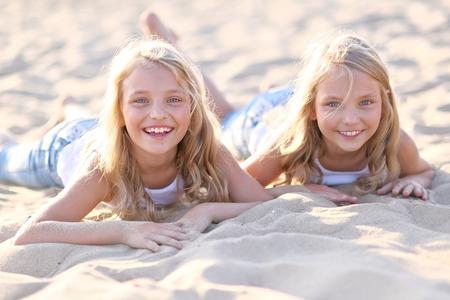 Portrait of two little girls twins Reklamní fotografie - 38493371