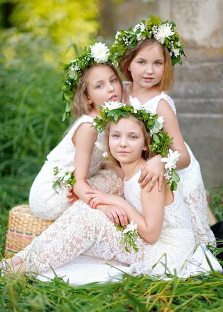 portrait of three girls in a wedding style