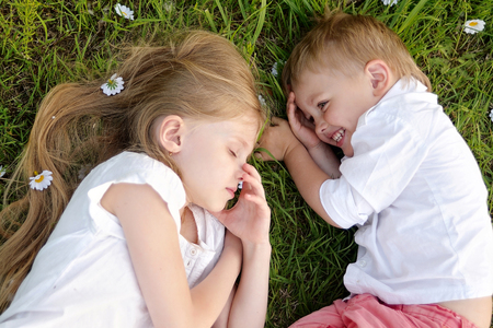 toddler boy: Portrait of a boy and girl  in summer Stock Photo