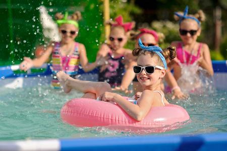 Portrait of children on the pool in summer Archivio Fotografico