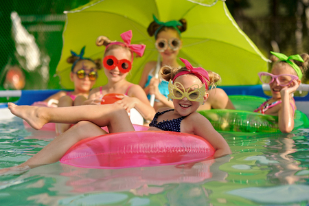 Portrait of children on the pool in summer Stock Photo