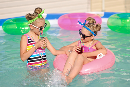 merriment: Portrait of two girls in a swimming pool