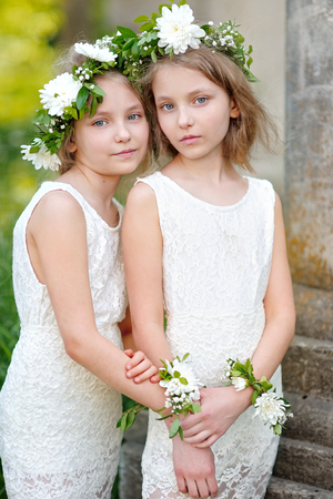 Portrait of two little girls twins