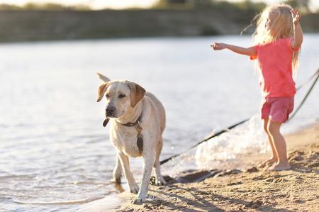 animal health: portrait of little girl outdoors in summer Stock Photo