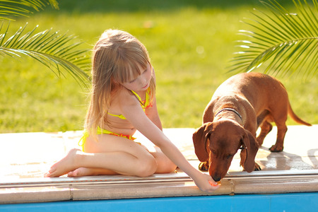 swimming animal: portrait of little girl outdoors in summer Stock Photo