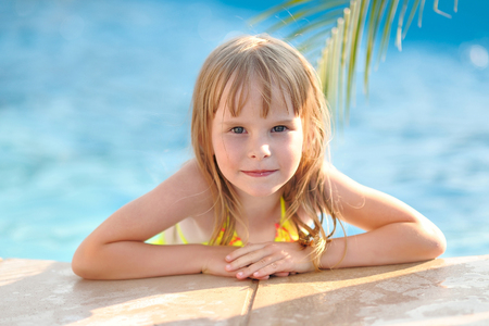 swimsuits: portrait of little girl outdoors in summer Stock Photo