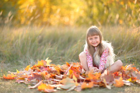 wilting: portrait of little girl outdoors in autumn Stock Photo