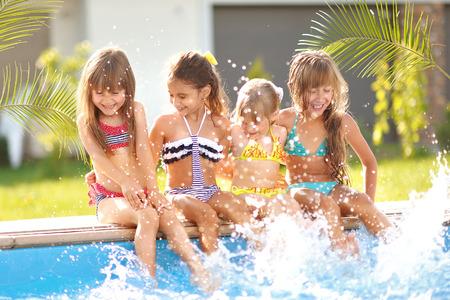 Portrait of happy children on nature in summer