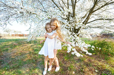 joyfulness: Portrait of two little girls girlfriends spring
