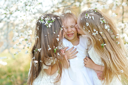 exhilaration: Portrait of little girls sisters in spring Stock Photo