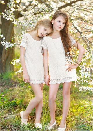 Portrait of two little girls girlfriends spring