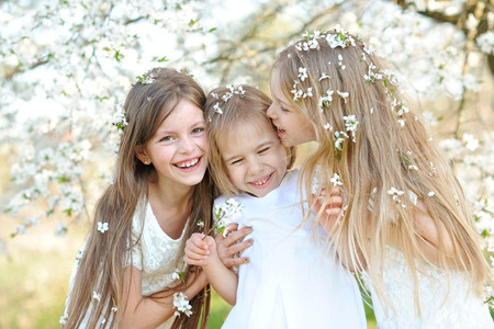 joyfulness: Portrait of little girls sisters in spring Stock Photo