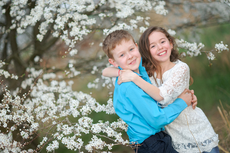 Portrait of a boy and girl in the lush garden photo