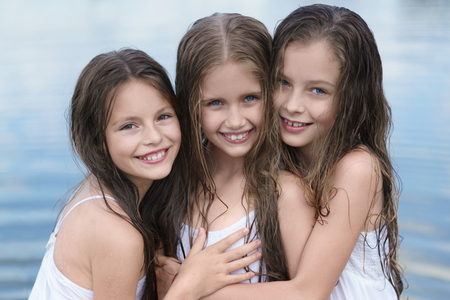 Portrait of three girls in the woods girlfriends photo
