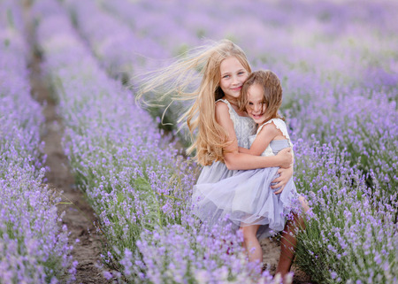 portrait of two sisters in a lavender field