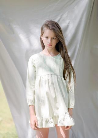 portrait of little girl outdoors in summer Фото со стока