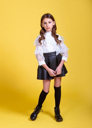 portrait of little model girl in studio