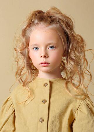 portrait of little model girl in studio Banco de Imagens